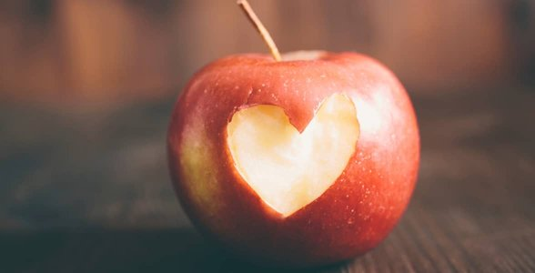 Photo of an apple with a heart-shaped bite in it