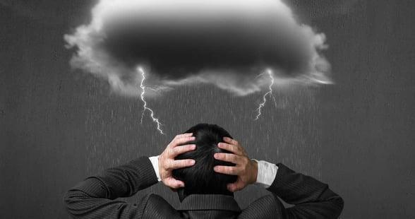 Photo of a rain cloud over a man's head