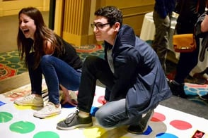 Photo of two people playing Twister at an unplugging event
