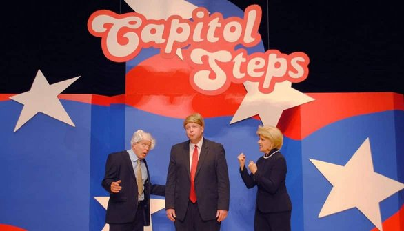 Photo of Capitol Steps members onstage during a performance