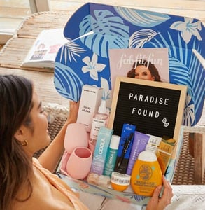 Photo of a woman opening a FabFitFun box