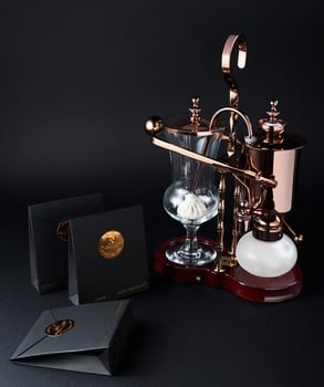 Photo of Black Ivory Coffee and the special coffee brewer