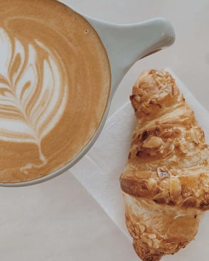 Photo of PT's coffee and croissant