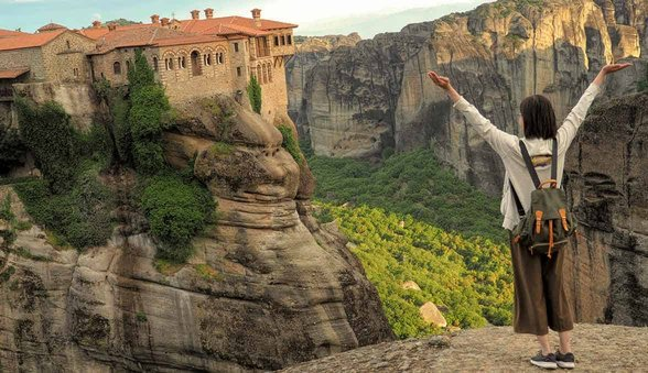 Photo of cliffside monastery in Meteora, Greece.
