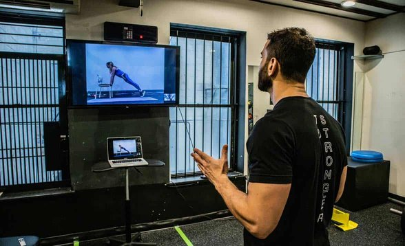 Photo of TS Fitness Founder Noam Tamir conducting a virtual workout