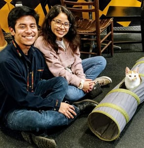 Photo of a couple adopting a cat