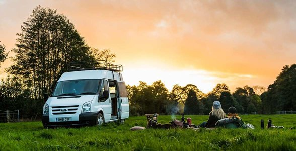 Photo of a couple with a campervan