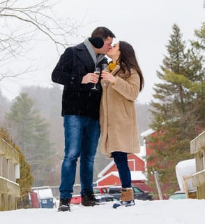 Photo of couple in the snow at Stone Hill Inn