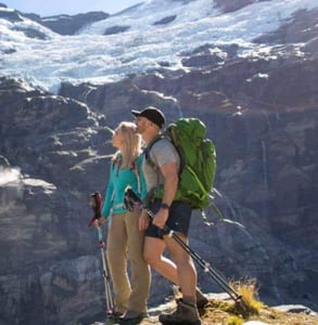 Photo of a couple hiking in the mountains