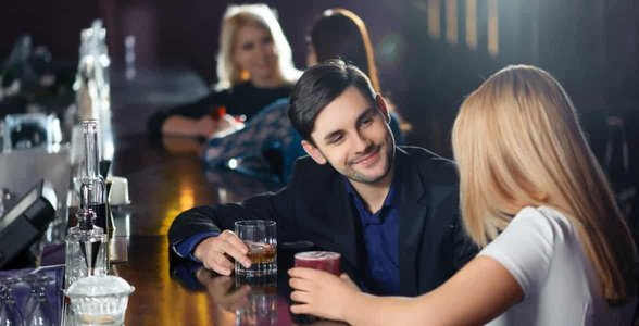 Photo of a couple at a bar