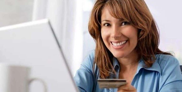 Photo of a woman paying for online services
