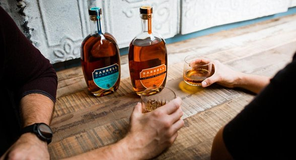 Photo of couples sharing Barrell Craft Spirits drinks