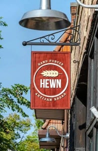 Photo of the Hewn sign