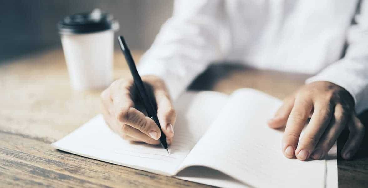 Photo of a man writing