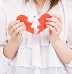 Photo of someone holding a ripped heart