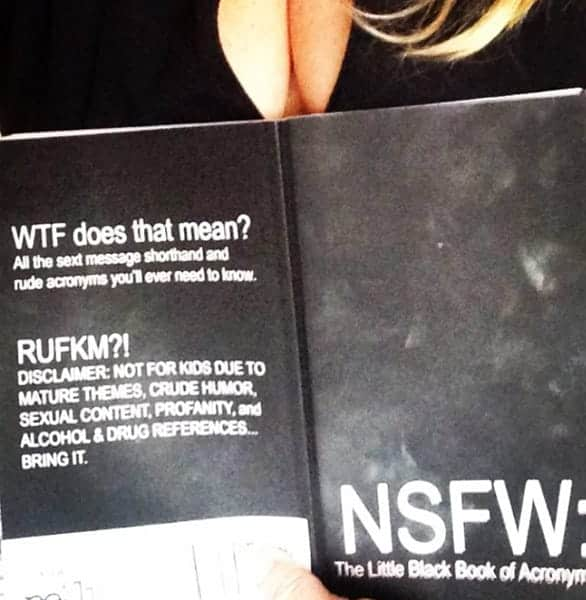 Photo of a woman reading NSFW