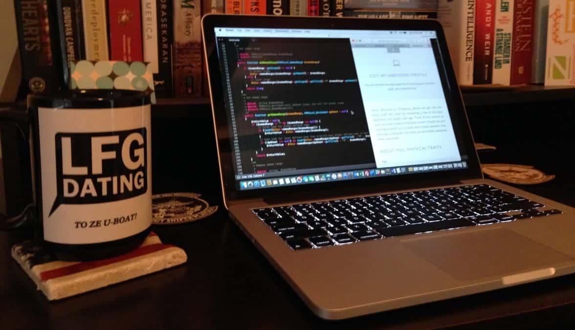 Photo of a LFGdating mug and laptop