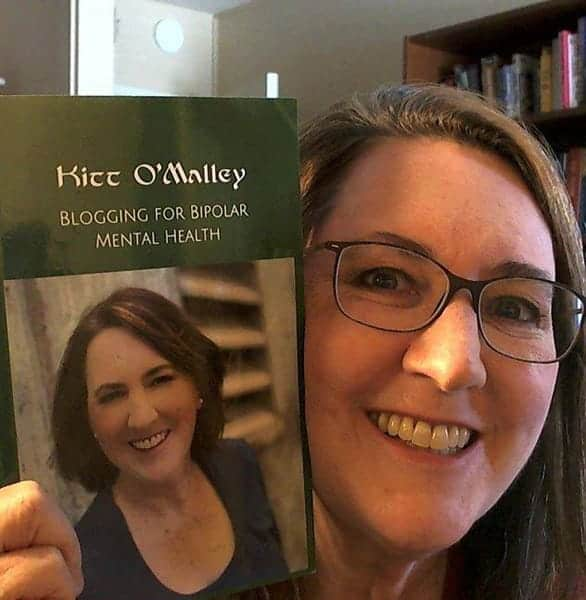 Photo of Kitt O'Malley with her book