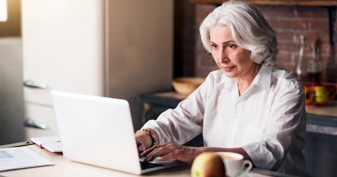 Photo of a senior woman on a laptop