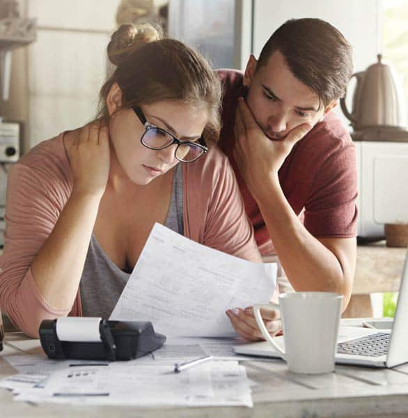 Photo of a couple stressed about money