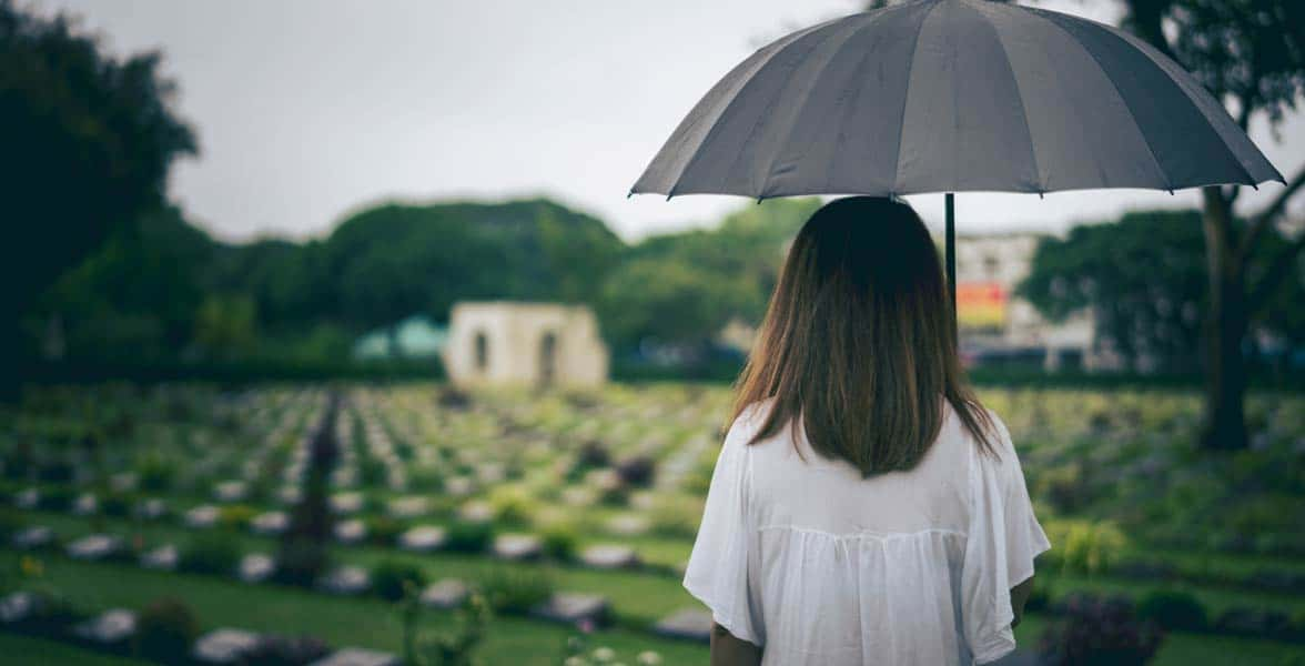 Photo of a woman at a cemetery